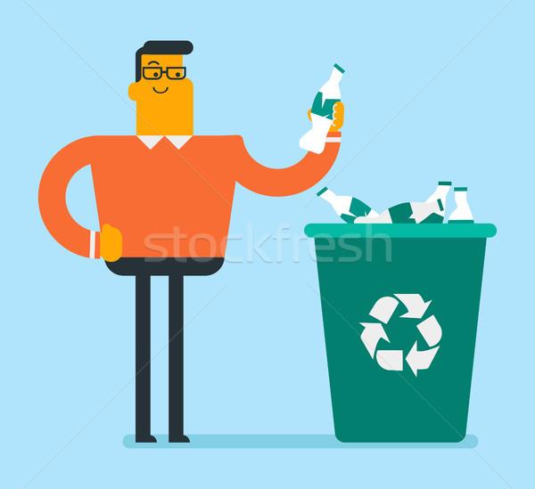 Man throwing plastic bottle into a recycling bin. Stock photo © RAStudio