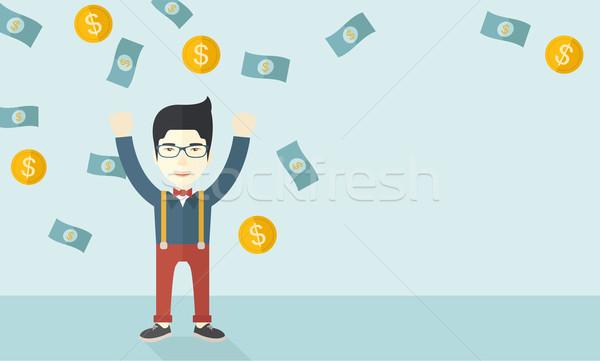 Young and cheerful chinese man. Stock photo © RAStudio