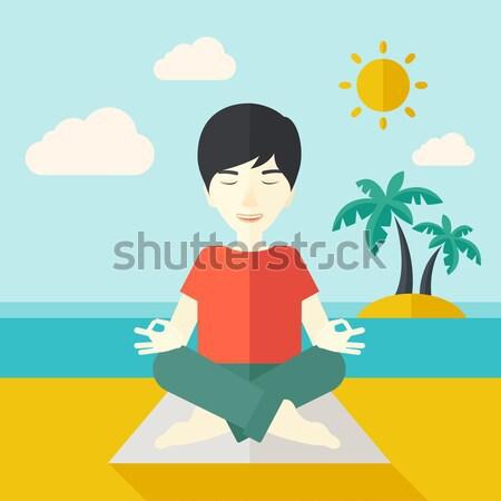 Asian man meditating Stock photo © RAStudio
