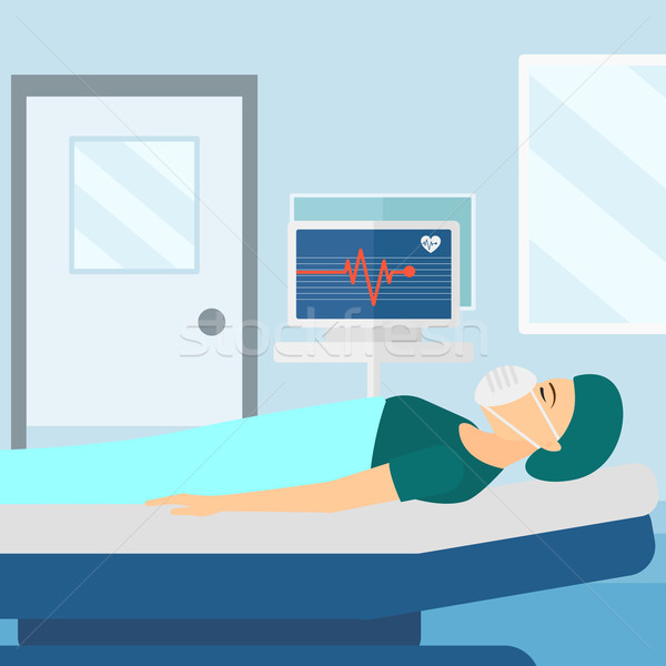 Patient lying in hospital bed with heart monitor. Stock photo © RAStudio