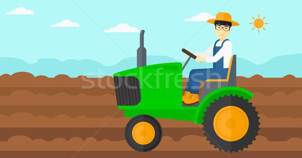 Farmer driving tractor. Stock photo © RAStudio