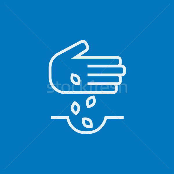 Hand planting seeds in ground line icon. Stock photo © RAStudio