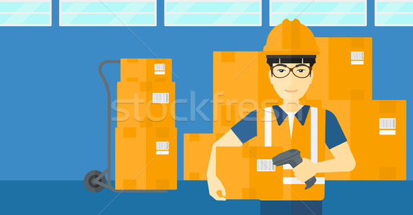Worker checking barcode on box. Stock photo © RAStudio
