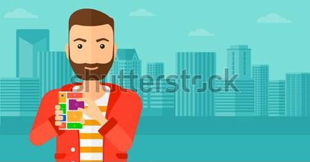 Man with modular phone. Stock photo © RAStudio