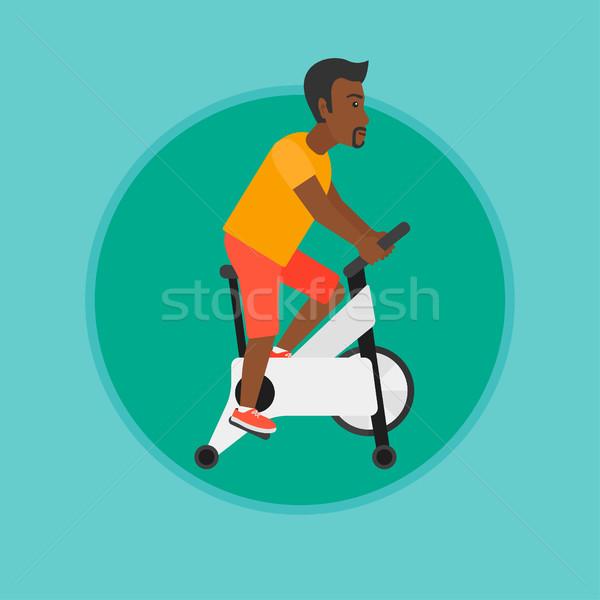 Férfi lovaglás mozdulatlan bicikli testmozgás képzés Stock fotó © RAStudio