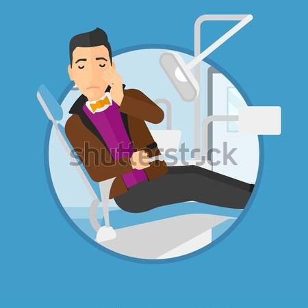 Férfi szenvedés fogászati szék fiatal beteg Stock fotó © RAStudio