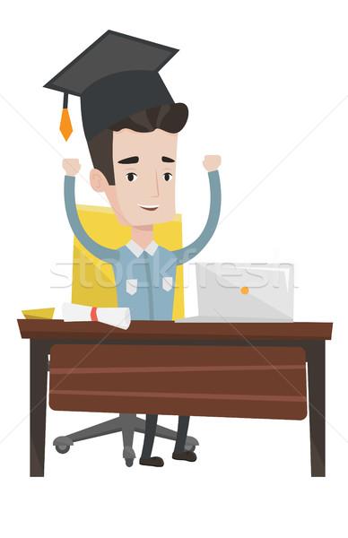 Absolvent mit Laptop Bildung Sitzung Tabelle Laptop Stock foto © RAStudio