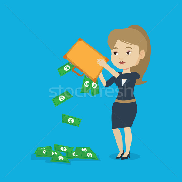 Bankrupt shaking out money from her briefcase. Stock photo © RAStudio