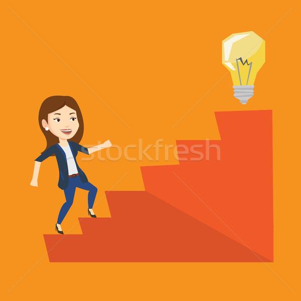 Business woman walking upstairs to the idea bulb. Stock photo © RAStudio