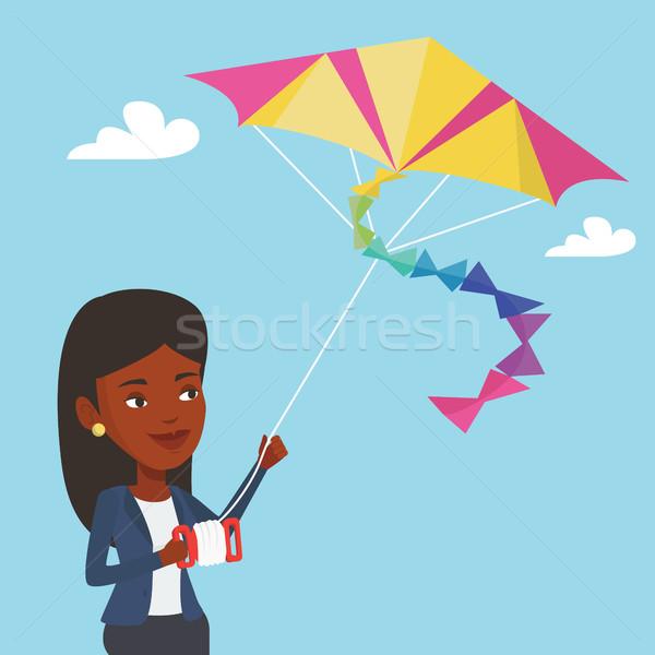 Young woman flying kite vector illustration. Stock photo © RAStudio