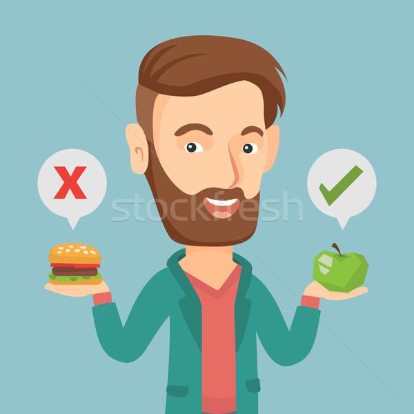 Homem escolher hambúrguer caucasiano Foto stock © RAStudio