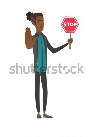 Caucasian stewardess holding stop road sign. Stock photo © RAStudio