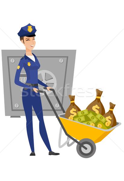 Polizia donna soldi spingendo carriola Foto d'archivio © RAStudio