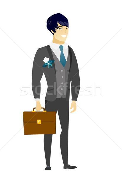 Asian groom holding briefcase. Stock photo © RAStudio