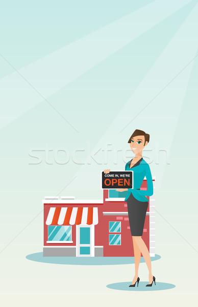 Caucasian shop owner holding open signboard. Stock photo © RAStudio