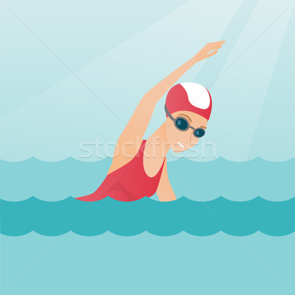 Young caucasian sportswoman swimming. Stock photo © RAStudio