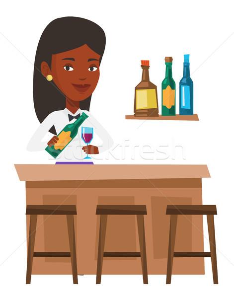 Bartender standing at the bar counter. Stock photo © RAStudio