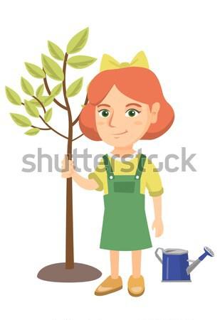 Mosolyog lány ültet fa áll újonnan Stock fotó © RAStudio
