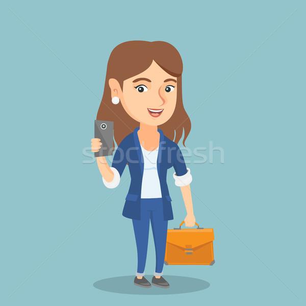 Femme d'affaires téléphone portable jeunes Photo stock © RAStudio