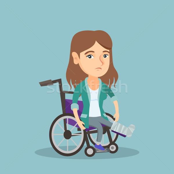 Woman with broken leg sitting in a wheelchair. Stock photo © RAStudio