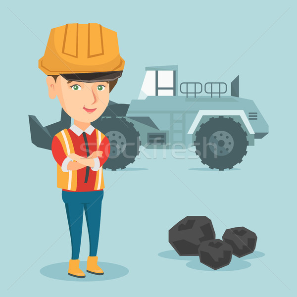 Miner standing on the background of an excavator. Stock photo © RAStudio