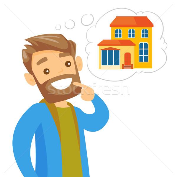 Caucasian white man dreaming about buying property Stock photo © RAStudio