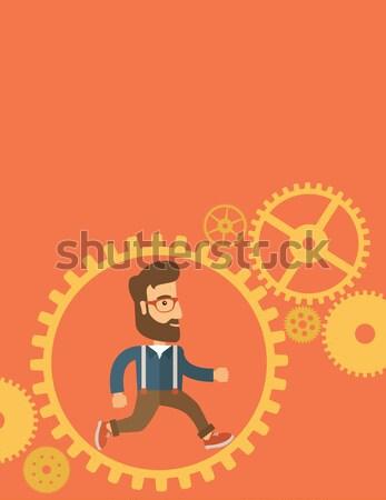 Japanese man running inside a gear. Stock photo © RAStudio