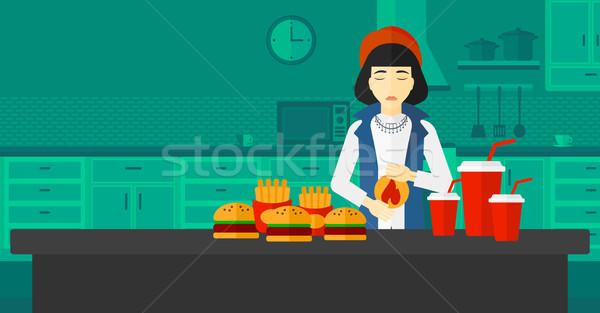 Vrouw lijden maagzuur asian permanente keukentafel Stockfoto © RAStudio