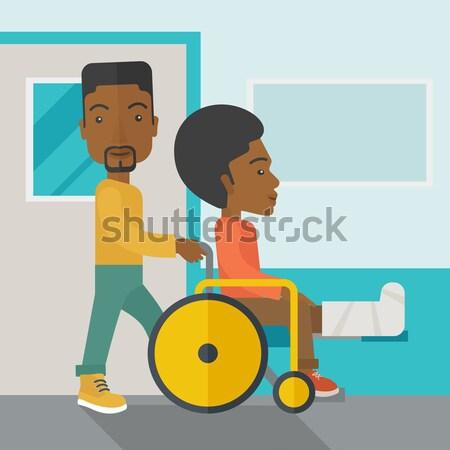 Man pushing the wheelchair with broken leg patient. Stock photo © RAStudio