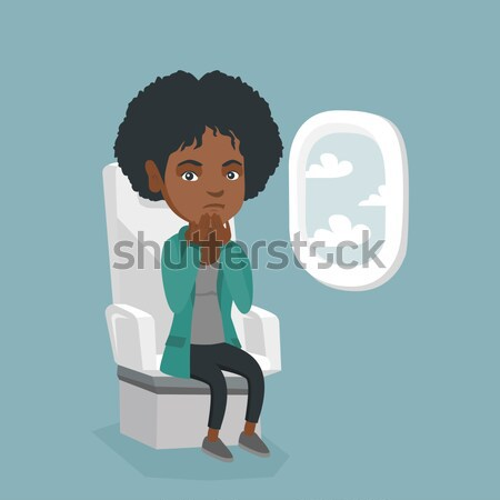 Young woman suffering from fear of flying. Stock photo © RAStudio