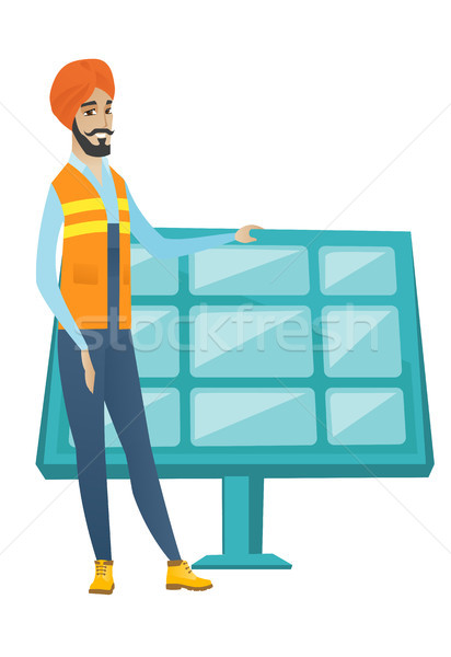 Young hindu worker of solar power plant. Stock photo © RAStudio