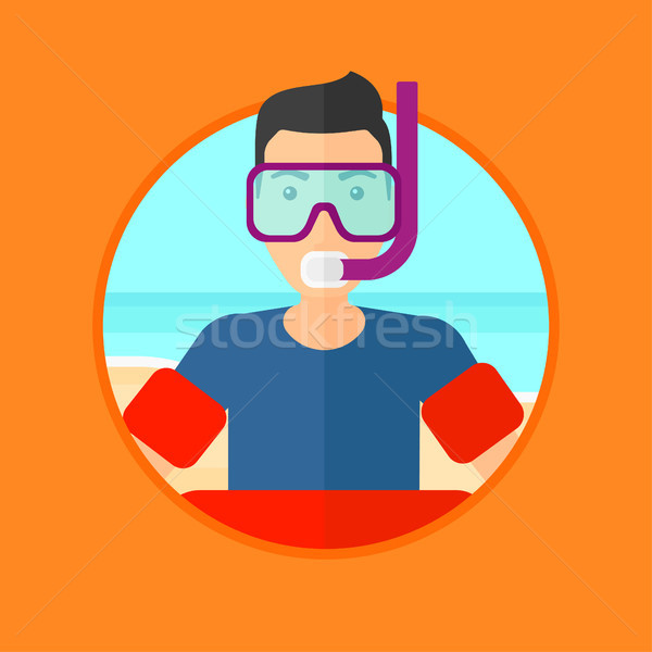 Man with snorkeling equipment on the beach. Stock photo © RAStudio