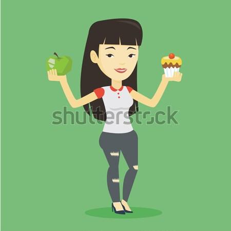 Mulher escolher maçã asiático Foto stock © RAStudio