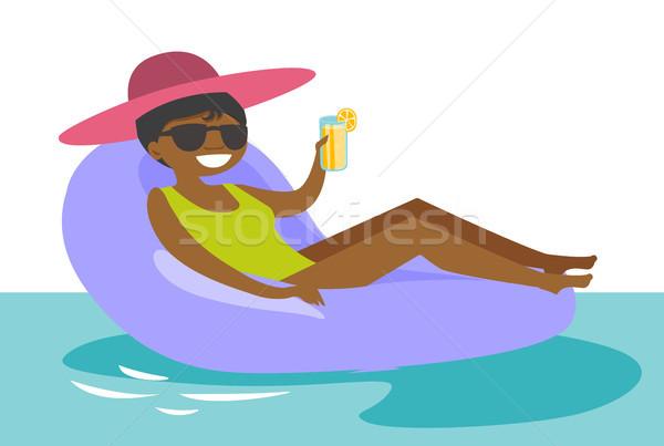 Kadın rahatlatıcı yüzme havuzu genç güneş gözlüğü Stok fotoğraf © RAStudio