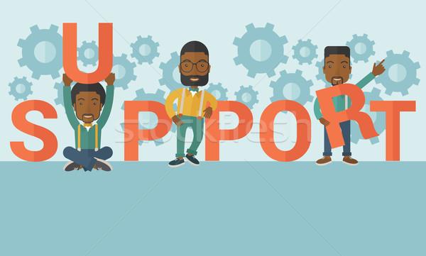 Three black men standing in the word support. Stock photo © RAStudio