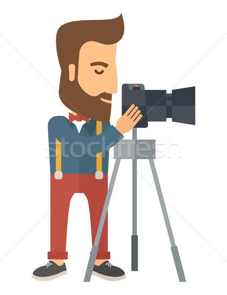 Photographer Standing preparing his camera with tripod. Stock photo © RAStudio