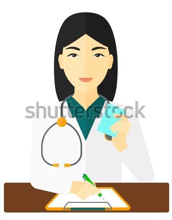 Pharmacist taking notes. Stock photo © RAStudio