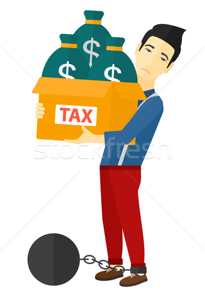 Stock photo: Chained man with bags full of taxes.