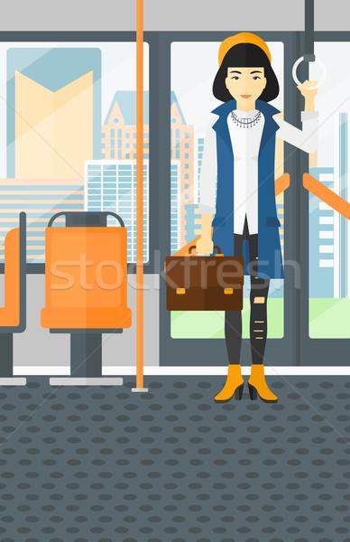Vrouw permanente binnenkant openbaar vervoer asian koffer Stockfoto © RAStudio