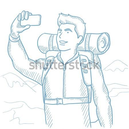 Backpacker making selfie. Stock photo © RAStudio