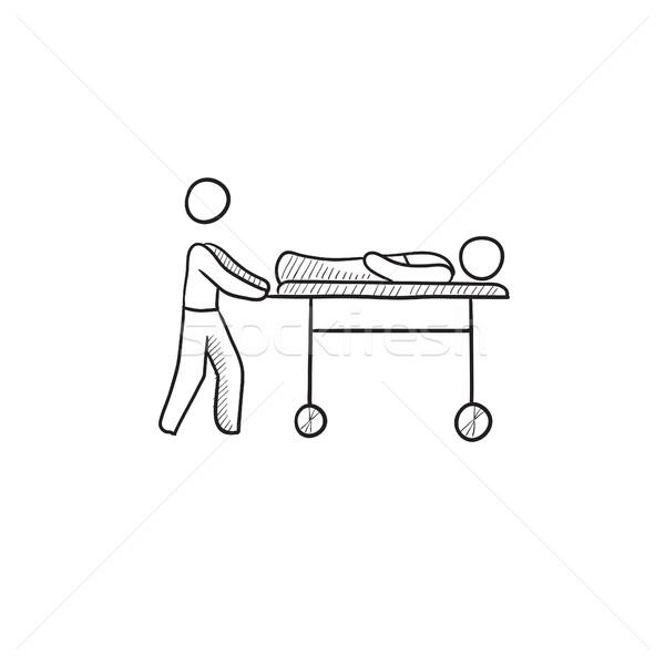 Stock photo: Man pushing stretchers sketch icon.