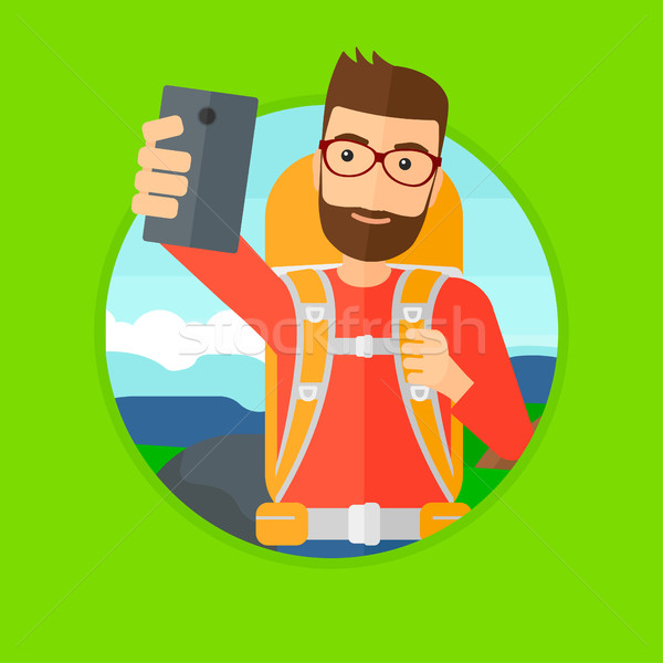 Man with backpack making selfie. Stock photo © RAStudio