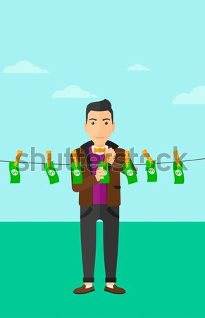Man holding plant growing in plastic bottle. Stock photo © RAStudio
