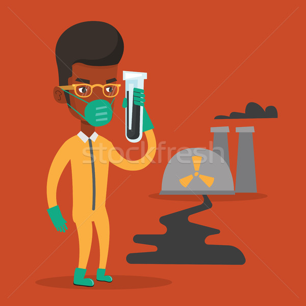 Man in radiation protective suit with test tube. Stock photo © RAStudio