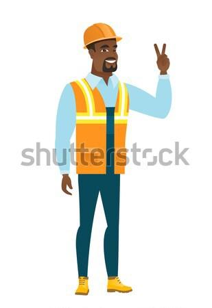 Budowniczy zwycięstwo gest Afryki Zdjęcia stock © RAStudio