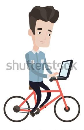 Hombre equitación bicicleta de trabajo portátil trabajo Foto stock © RAStudio