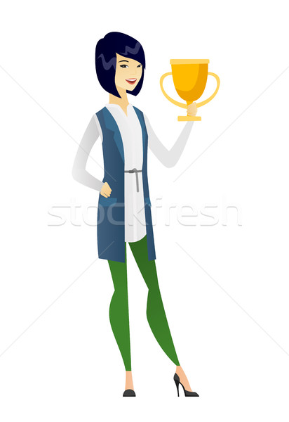 Asian business woman holding a trophy. Stock photo © RAStudio
