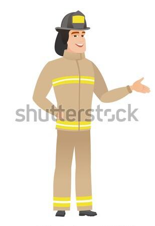 Young caucasian firefighter in uniform. Stock photo © RAStudio