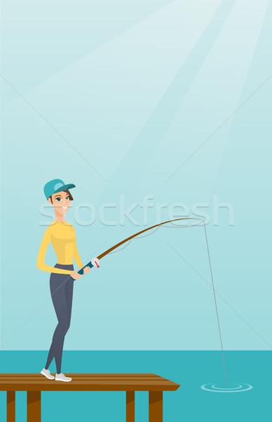 Fiatal kaukázusi nő halászat megnyugtató derűs Stock fotó © RAStudio