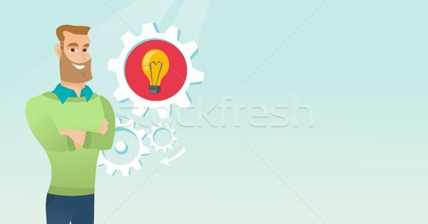 Caucasian man with business idea lightbulb in gear Stock photo © RAStudio